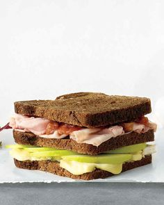 This unique three-decker sandwich features a layer of apple and brie and another layer of ham and chutney for a tart/creamy and savory/sweet interplay.