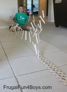 Build a chain reaction with popsicle or craft sticks. Good rainy day indoor #kids #activity