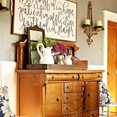 I Spy an Antique Farmhouse Candle Sconce above this lovely table styled by Tammy.