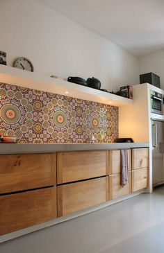 I like the idea of this crazy backsplash... would definitely do something more subtle (and with tile) for my own kitchen.