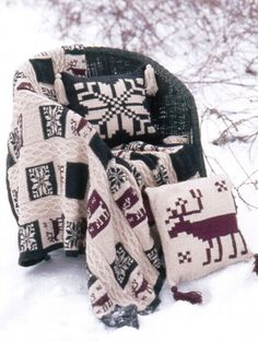 Not for the faint of heart, this afghan and pillow set has square Nordic motifs, burly moose, and strong cables repeated throughout. This wintery knit afghan pattern may take time, but the result is well worth it.