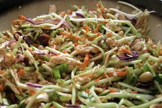 Yummiest Oriental Chicken Salad - 2 cooked chicken breasts, shredded; 1 bag BROCCOLI slaw; 2 tablespoons Sesame oil (or olive oil); 1/3 cup rice vinegar; 1/4 cup lite soy sauce (alternative); 1 tablespoon sugar (optional); 1/4 cup toasted almonds