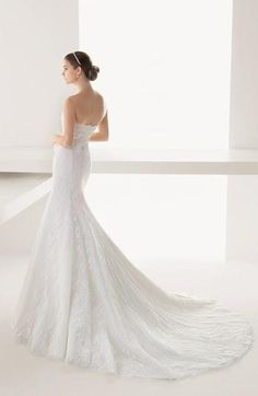 Vintage style wedding gown with an elegant fishtail train.