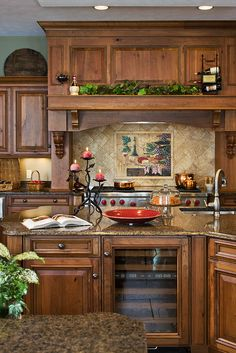 Log Cabin Kitchen With Glass Cabinets As Divider Wall