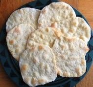 bread without yeast or baking soda  2 cups flour  2/3 cup water knead 10 mins bake 7 mins at 425 degrees on ungreased cookie sheet