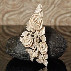 A beautiful finely detailed carving in deep relief of roses