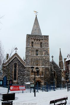 Church of St Mary the Virgin in Winter, Dover, Kent, England, UK: Bell Tower, weather vane, and clock of St Mary's parish church and snow. Church of England, CofE Listed Building. Lady Chapel in left-hand aisle, Organ in right. Tower sundial not in shot. Originally a Roman site: Saxon church burnt 1066, Norman church built pre-1086; Victorian restoration 1843-1844. Located Cannon Street, CT16 1BY. Urban Dover Architecture and Medieval History. See: http://www.panoramio.com/photo/99154939