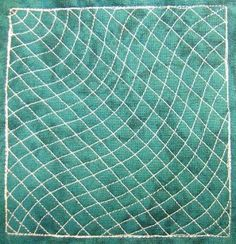 Matrix Rays - If you haven't yet talked yourself into trying free motion quilting, then now's the time to do it with this beginner's design. Learn how to stitch it right now at http://freemotionquilting.blogspot.com/2010/05/day-171-matrix-rays.html