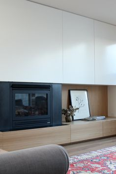 minimal tv storage   oak   timber   white   modern cabinetry   fireplace   living room   Pipkorn & Kilpatrick Interior Architecture and design   Clifton Hill house