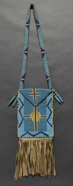 Inspiring Blackfoot beaded hide hunting bag, ca 1870s, with geometric, cross, and lightning designs in blue and yellow