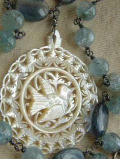 Blue Bird    Vintage Hand Carved Mother of Pearl Pendant Aquamarine Gemstone Handmade Assemblage Necklace. $165.00, via Etsy.