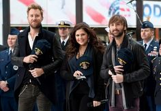"""Charles Kelley, Hillary Scott and Dave Haywood of Lady Antebellum salute the USS New York for a special Veterans Day performance on the """"Today"""" show on Nov. 11 in New York"""