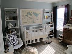 This framed vintage map is the perfect focal point in this #nautical themed nursery.