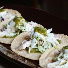 ... tortillas filled with chicken, fresh tomatillo salsa, cabbage, crema