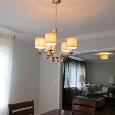 Lauren of The Starter Home Diaries upgraded the semi-flushmount light in her dining room to a gorgeous Progress Lighting chandelier. See the total transformation on her blog: http://www.starterhomediaries.com/dining-room-chandelier-install-reveal/