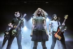 Ready to rock. The Band Perry's Neil Perry, Kimberly Perry and Reid Perry command the stage during a performance on Dec. 2 in London