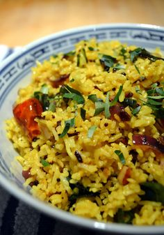 South Indian Coconut Rice  1/2 large onion  3 cloves of garlic  About 15 fresh or dried curry leaves  1 tablespoon coconut oil or any neutral oil  3-4 whole dried chilies  1 teaspoon black mustard seeds  2 cups cooked rice, preferably leftovers  1 teaspoon turmeric  1 cup coconut milk