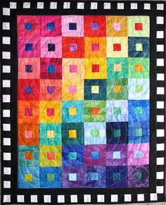 Black and white border to contrast with bright quilt center.