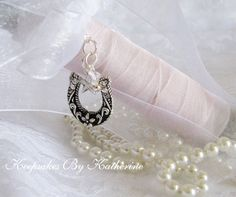 There is an Irish wedding tradition where the bride carries a horse shoe down the isle...Western Wedding Bouquet Charm Horseshoe by KeepsakesByKatherine.