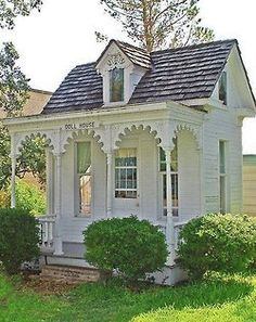 What a wonderful playhouse in a Victorian backyard.