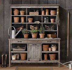 a great place for a greige look. re-purposed buffet and hutch make a wonderful potting bench. I love the terracotta addition to the palette