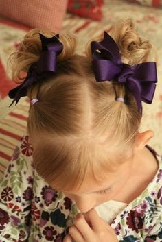 Lots of cute little girl 'do's. Very helpful for moms of girls!