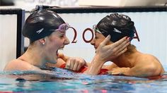 Missy Franklin celebrates winning the Women's 200m Backstroke Final with team mate Elizabeth Beisel on Day 7 of the London 2012 Olympic Games at the Aquatics Centre