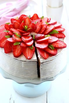 Great inspiration is this checkerboard cake and beautiful Strawberry Design on top of the cake. (This is in another language but I'm pinning it for the strawberry flower design because it's so pretty and looks easy to duplicate.) Could even make it look more like a poinsettia for Christmas!