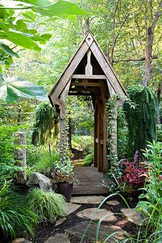 Handcrafted bridges were among the first additions to homeowner Ellen Lathi's expansive garden. This one was given a weeping larch on either side and an akebia vine that softens its lines. See the rest of her magical garden here.
