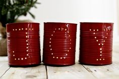 """JOY Holiday Tin Luminaries--Upcycle your tin cans.  Includes instructions on how to make """"punching"""" the can easy."""