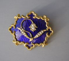 """VICTORIAN royal blue transparent enamel and seed pearls lily-of-the-valley brooch set in gold tone metal, 1-3/4"""" by 1-1/3"""". There is a is a tiny 1/8"""" nick on back where someone tested for gold, does not show at all from the front. The lily-of-the-valley was a symbol of remembrance in the Victorian era"""
