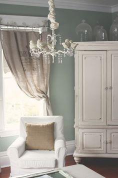 neutral blue walls, white chandelier, burlap details