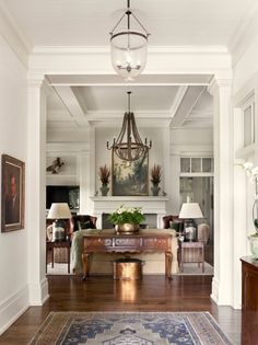 white walls with heavy white molding and hardwood floors.  I see a flying duck mount on the wall in the family room