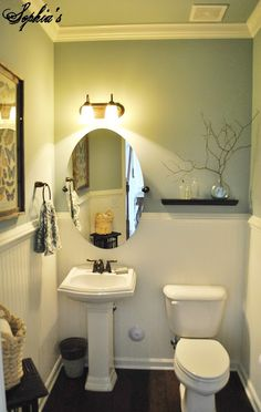 Sophia's: Powder Room Makeover; Great look for a small bathroom.  Love the beadboard, the crown moulding around the ceiling and the flooring