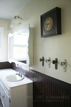Vintage door knobs as towel holders. You can get these at Hobby Lobby