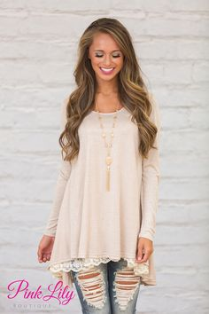 This Lovely Lace tunic is just that...lovely. Soft taupe colored material with the cutest lace detail along the hemline. This tunic is beautiful enough to dress up but comfortable enough to wear every day.