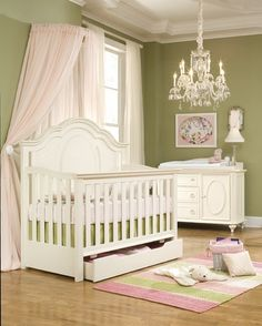 love the idea of a PRETTY nursery for a little girl instead of a cutesy one... loving the chandelier and curtains that drape around the crib! also obsessed with the white furniture
