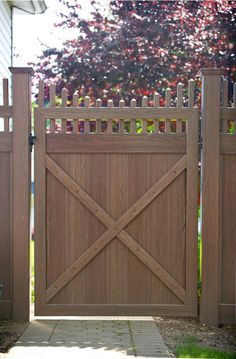 VWG3707-46 Tongue and Groove Vinyl Privacy Walk Gate with Scalloped Classic Victorian Picket Topper. Shown in Grand Illusions Vinyl WoodBond Walnut grain (W103).