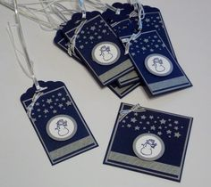 This set uses the White Christmas Photopolymer stamp set along with the Stars Confetti punch and All Is Calm Designer Washi Tape. 1 1/8″ Silver ribbon pulls it all together and the Scallop Tag Topper punch tops it all. The cardstock is Night of Navy, Brushed Silver and Whisper White. The snowman is stamped with Night of Navy and punched out with the 1″ Circle Punch and layered on 1 1/4″ Circle punched out of Brushed Silver.
