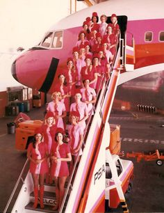 PSA stewardesses in pink uniforms and a pink plane!