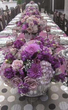 Lush, Purple and lavender low centerpieces.