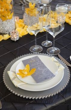 Yellow Floral Reception Decor . Yellow and grey looks good together