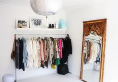 Cool Clothes Rack, i like the shelf above it.