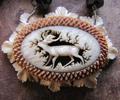 Black Forest Stag Necklace. Gorgeous carved deer in stunning setting.  Chain of gemstones and old sterling chain.