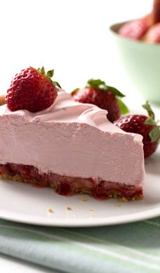 Very Strawberry Mousse Pie — Frozen whipped dessert topping forms the mousse with fresh strawberries, strawberry syrup and jam. With low-fat, sugar-free products, the calories won't even make a dent in your diet. #recipes #desserts #easy #spring
