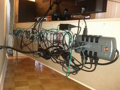 Hide your cables and keep them off the floor for easy cleaning - OH GOD YES