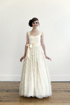 Cascades of tiny tulle ruffles make this a dress to dream of. Tea/Blush wedding gown by englishdept on Etsy. $2,400.00, via Etsy.