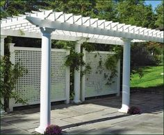 panel in front of compost- pergola behind garage and kitchen wall