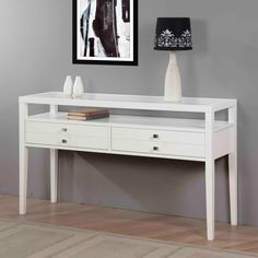 Aristo Gloss White Sofa Table   Overstock.com,  Great for home office, printer/fax on top.  In & out bins on shelf.  Paper & supply storage. Even room below for the doggy bed when he wants to be near.