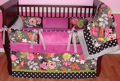 Cassandra Baby Bedding  Included in this luxurious 3 piece set is the bumper, crib blanket, and tailored crib skirt with trim.  There is lots of detail in this custom set including soft raspberry minky, black and white polka dots, silver grosgrain bows, silver minky, and designer floral fabric.